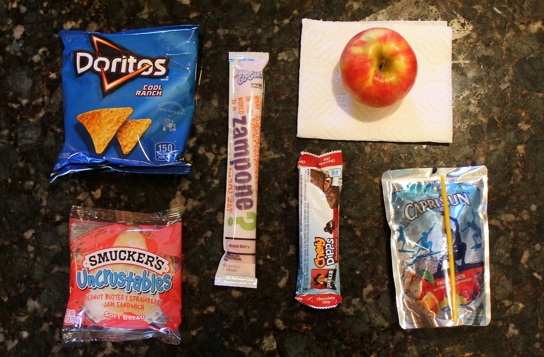 Keep items separate from one another to avoid cross contamination, and never reuse packaging. One way to do this is to use packaged foods such as granola bars, juice boxes and chips. (Photo by Allison Steines)
