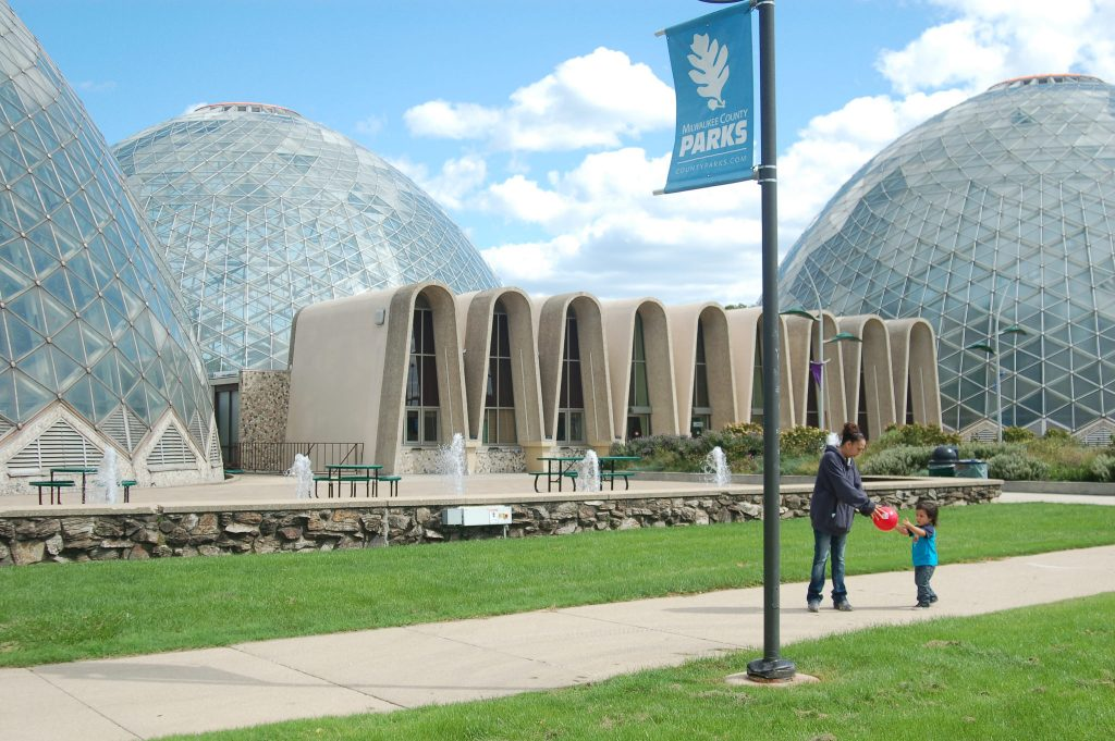 The second of three Mitchell Park Domes, the Tropical Dome (pictured right), reopened recently after being shuttered in February. (Photo by Edgar Mendez)