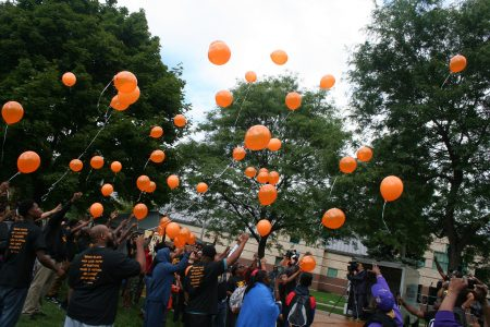 Attendees release balloons in a tribute to Eric Von, the iconic Milwaukee media personality who recently died unexpectedly. (Photo by Jabril Faraj)