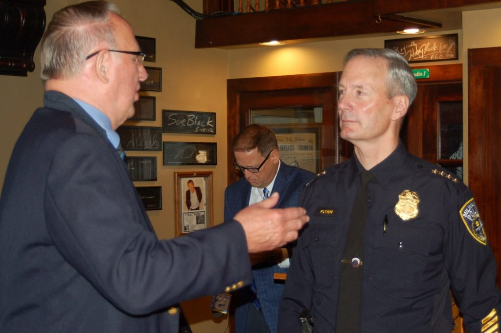 Police Chief Ed Flynn (right) chats with former Milwaukee Press Club president Wayne Youngquist after speaking at the Newsroom Pub. (Photo by Naomi Waxman)