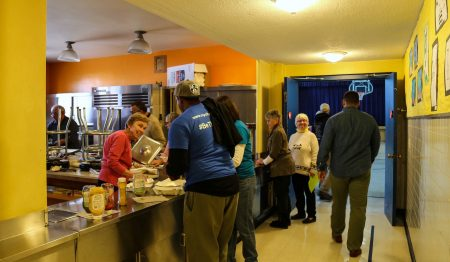 "Volunteers are served bowls of chili after several hours of cleaning streets and alleys in the Sherman Park ""Tri-Block"" area. (Photo by Allison Steines)"