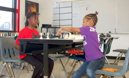 Qamari Lay from Siloah Lutheran School chess club and Ziporah Anderson from the Evangel Assembly of God chess club play a round of chess during a tournament at Siloah Lutheran School.