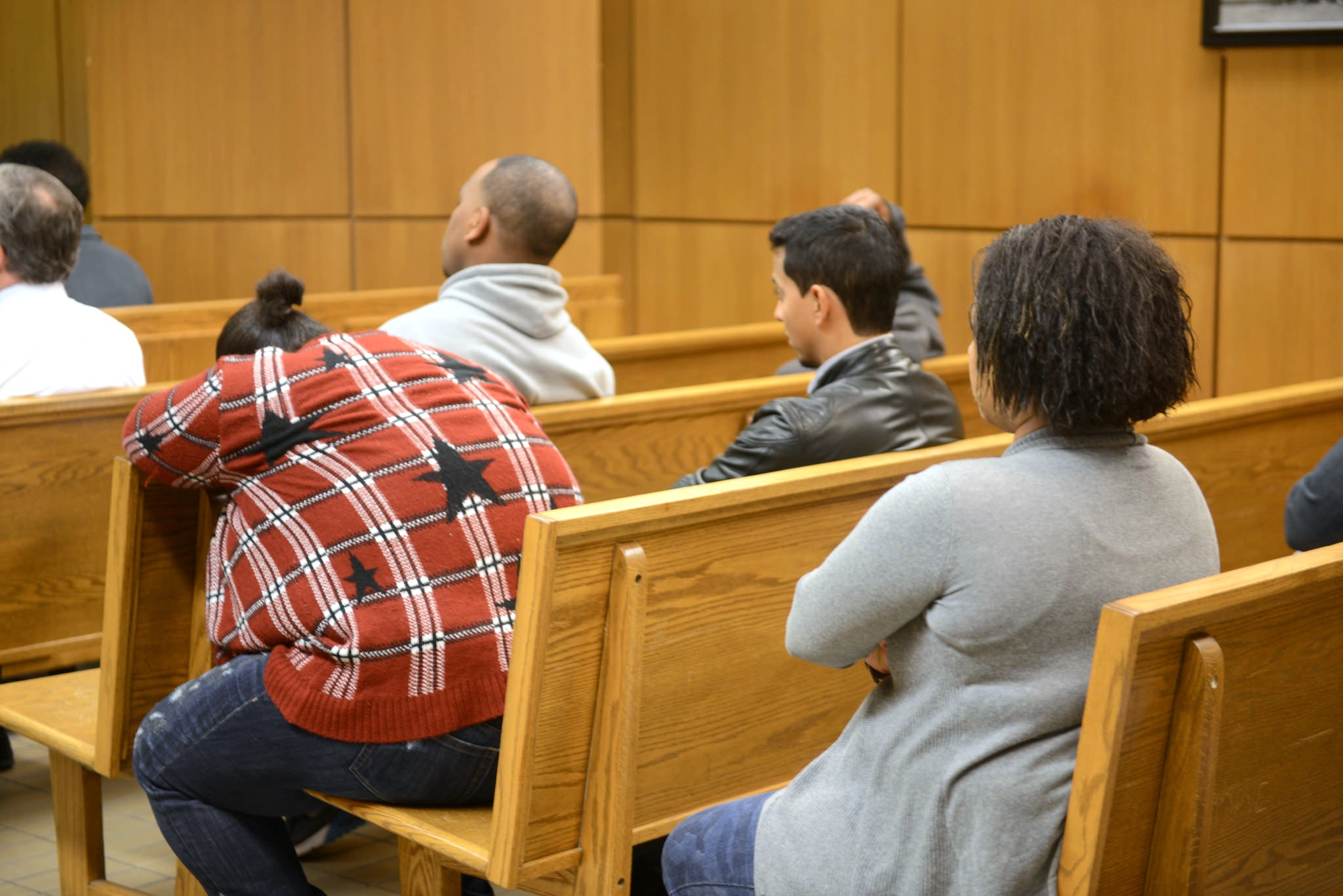 People wait for court proceedings to begin inside a Milwaukee Municipal courtroom. (Photo by Sue Vliet)