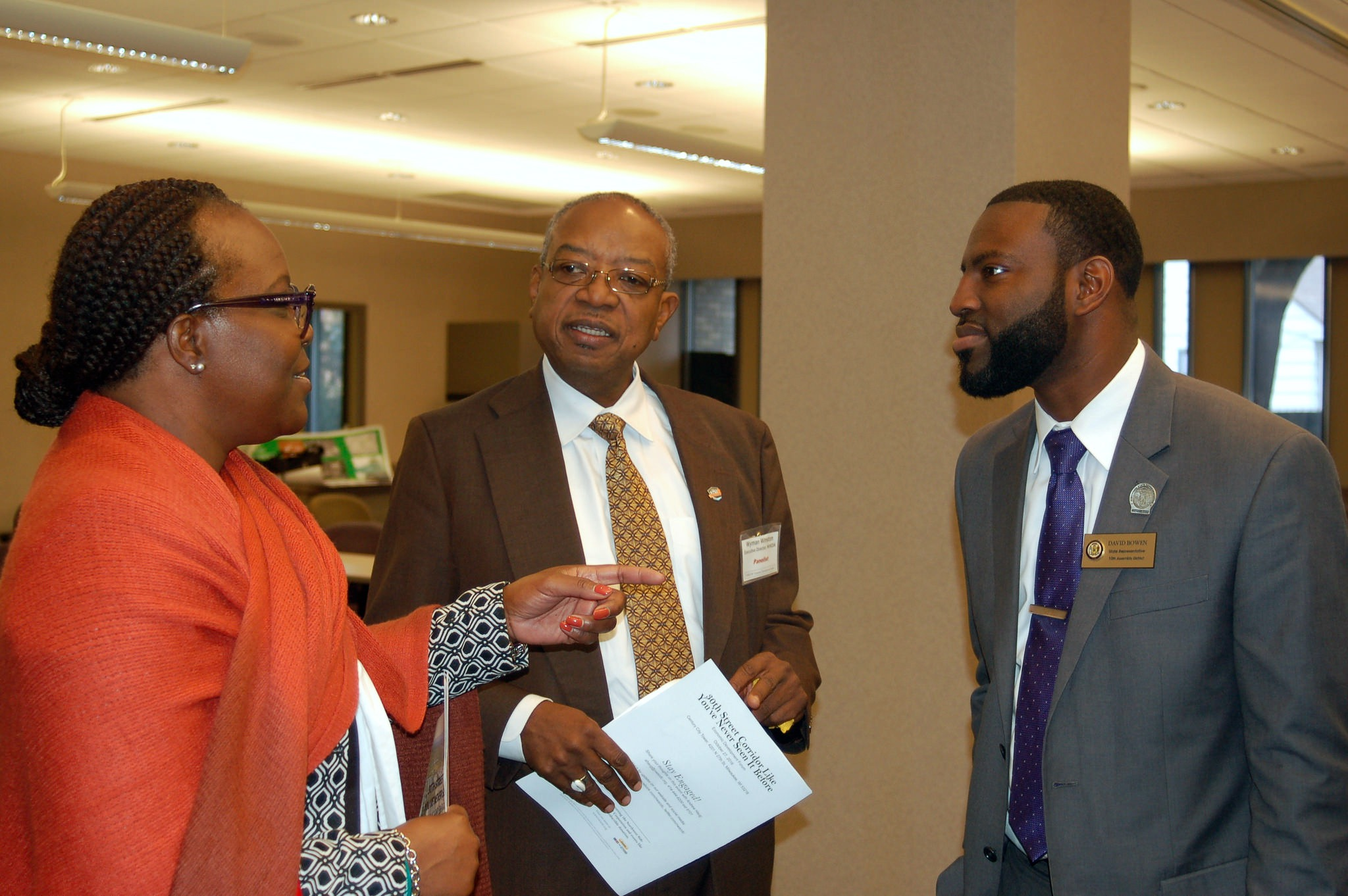 "Tri-Success Management Institute, Inc. President Ylonda Glover, WHEDA Executive Director Wyman Winston and Rep. David Bowen talk after the economic development forum, ""The 30th Street Corridor Like You've Never Seen It Before."" (Photo by Naomi Waxman)"