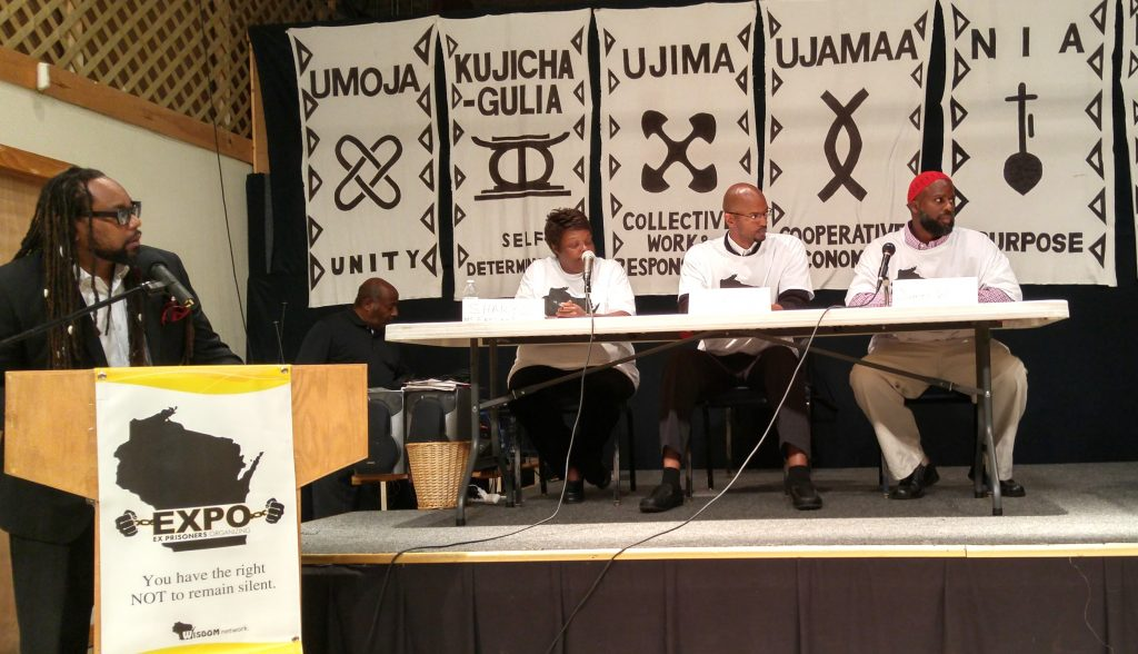 From left: Milwaukee Journal Sentinel columnist James Causey; Clayborn Benson, executive director, Wisconsin Black Historical Society (obscured); EXPO of Milwaukee leaders Sharyl McFarland, Carl Fields and James Watkins participate at an EXPO of Milwaukee community forum at the Wisconsin Black Historical Society in June.