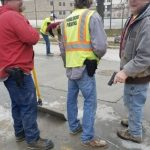 Controversial photo of city contractors with guns prompts reaction along racial lines
