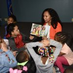 Book author reads to children at MCFI