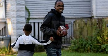 Youth coach uses football to teach players life lessons on and off field