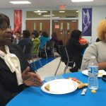 Intergenerational participants talk about community at On the Table dinner