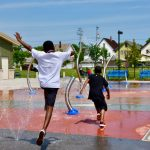 Kids enjoy the splash pad at Moody Park.