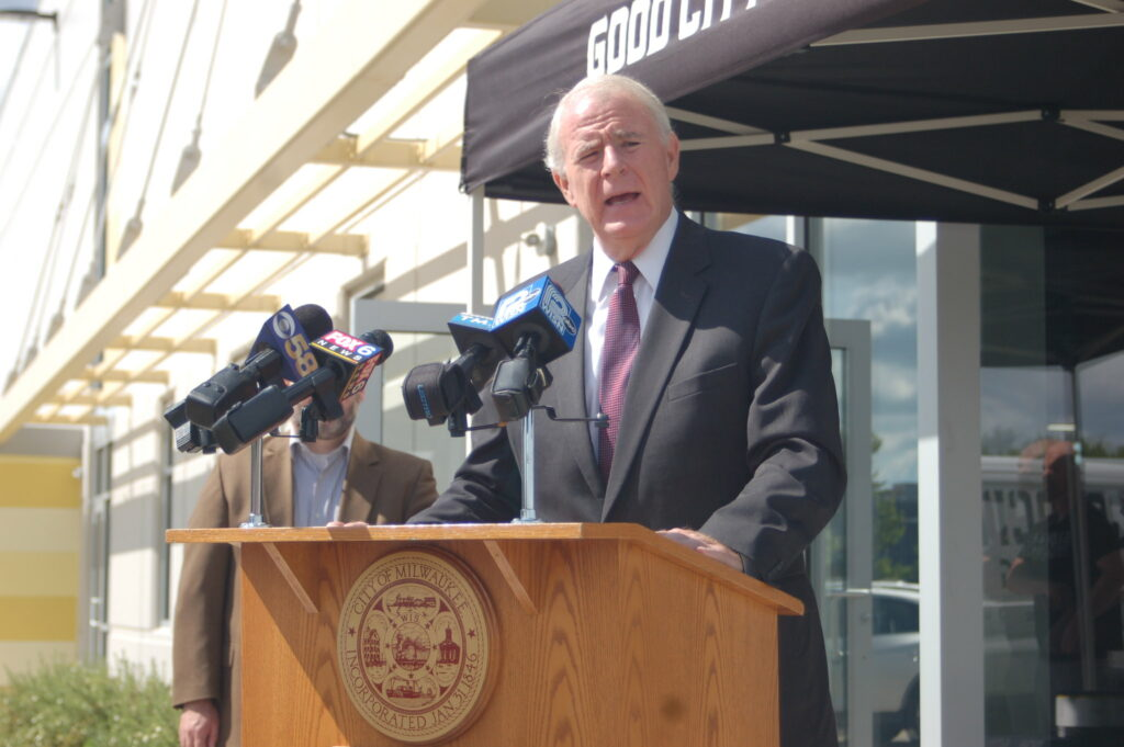 Mayor Tom Barrett, shown in 2018, standing at a podium.